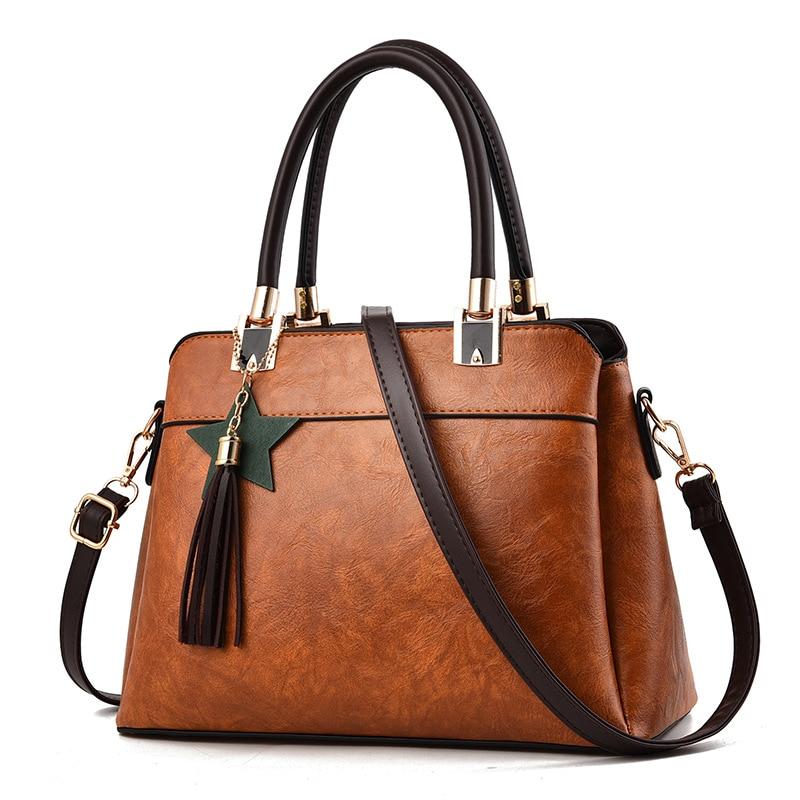 High Quality pu ladies shoulder bags black handbags for women fashion european Top-Handle Bags tassels Female hand bag new 2018
