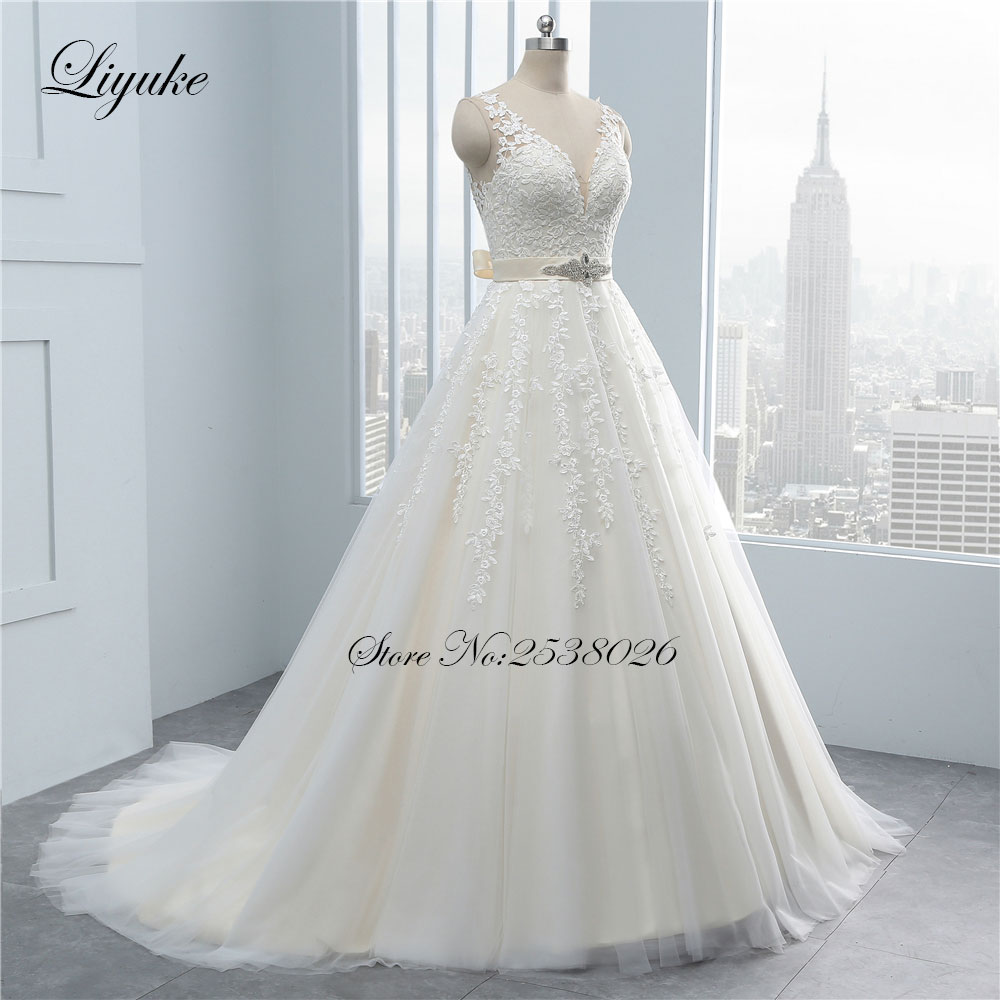 Vintage Deep V-Neck Appliques Lace A-Line Wedding Dress With Beading Sashes Sleeveless Silky Organza Backless Wedding Gown