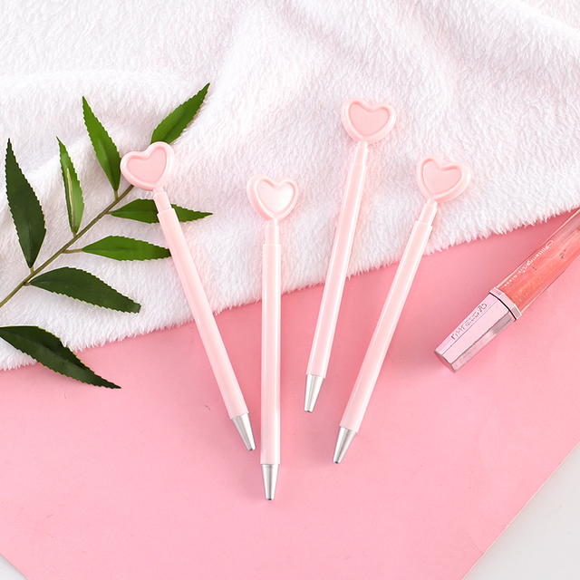 36 pcs/Lot Pink heart gel pen Pink color body Press type writing signature pens Stationery Office supplies Canetas escolar F706