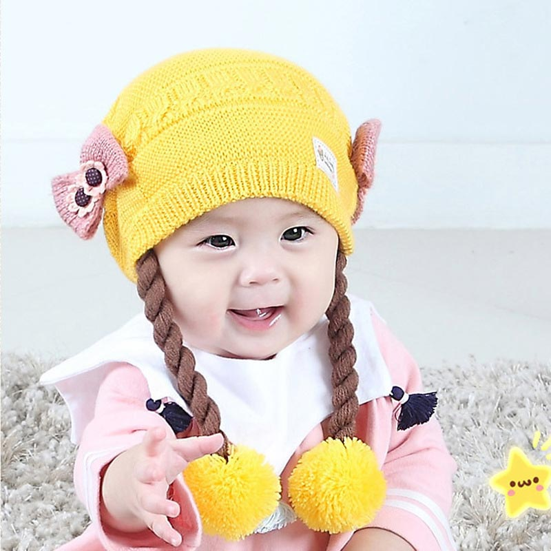 9047e45e253 Details of Cute Baby Wig Hats Bow knot Children s Knitted Braids Hat For 3  to 18 Months Baby Girls Infant Caps Winter Autumn Head Supplies click image.