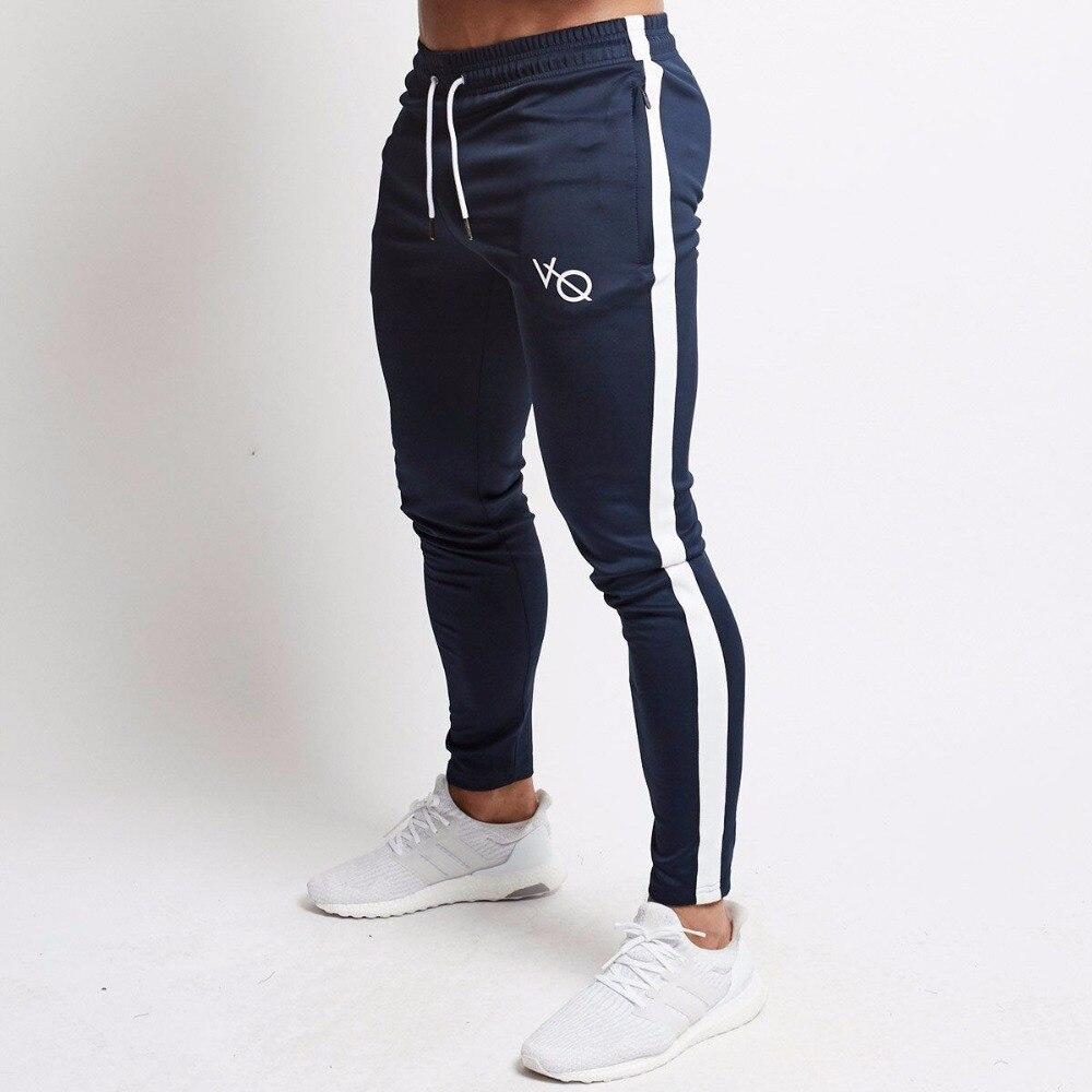 Hombre Joggers pantalones casuales pantalones de aptitud de los hombres ropa deportiva pantalones de chándal ajustados pantalones de chándal Pantalones negro gimnasios Jogger Pantalones