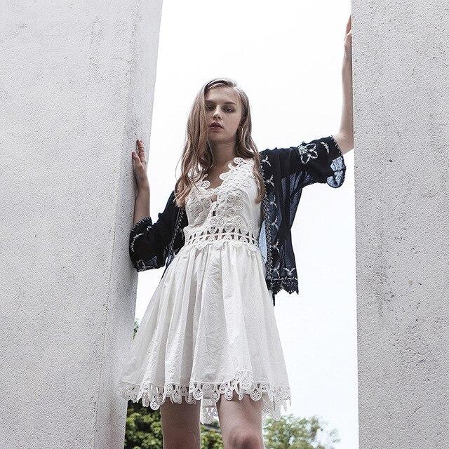 2a7404716a4 Europe summer sundress women deep v-neck sexy backless lace hollow white black  dress spaghetti strap cute beach bohemian dress