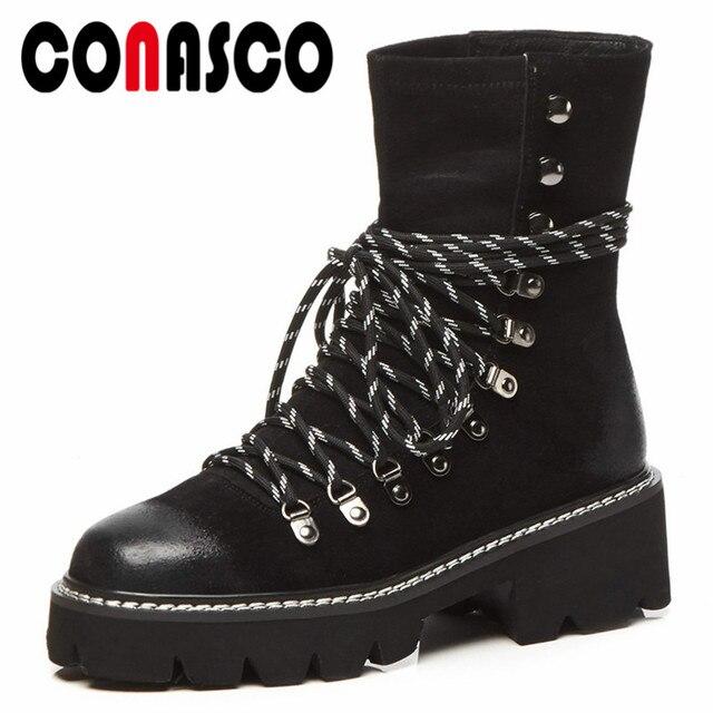b532ddef684 Las nuevas botas de gamuza de vaca de CONASCO de tacón alto remaches de  encaje Sexy botas de motocicleta de las señoras calientes de otoño invierno  zapatos