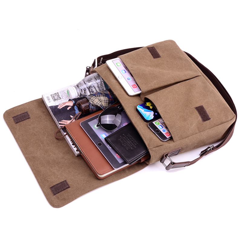 photo of a canvas laptop bag with a tablet, sunglasses and school materials
