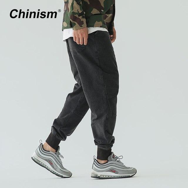 b92b984cda1 CHINISM hombres Ocasionales de Mediana Altura Pantalones Basculador Negro  Cordón Hacer Viejo Vintage Jeans 2017 Loose
