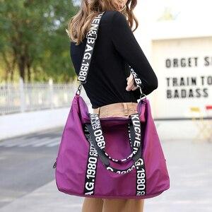 Image 1 - 2020 New bag Woman Travel Bag Black Pink Sequined Shoulder Bag Women Ladies Weekend Portable Travel Waterproof big Bag