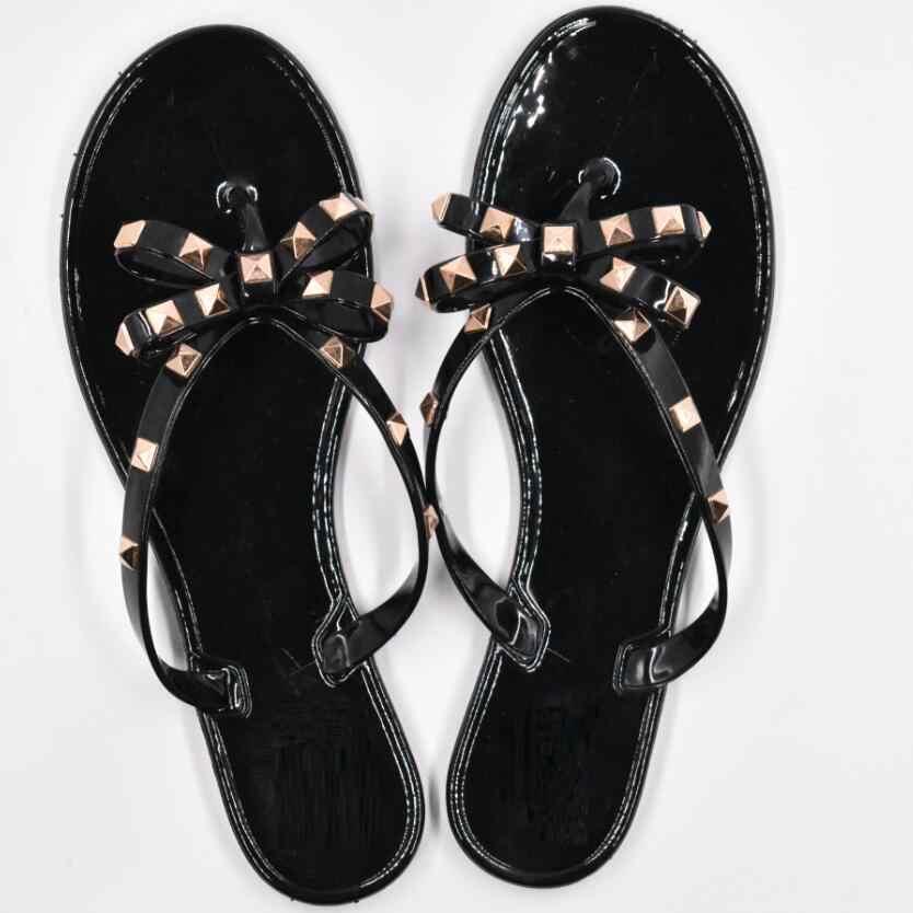 Caliente 2017 moda mujer Chanclas Zapatos de verano fresco playa remaches gran arco Sandalias planas marca jelly Zapatos Sandalias niñas tamaño 36-40