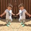 2017 estilo del verano del bebé niño ropa de algodón de dibujos animados de coco árbol t-shirt + pescados de la manera pantalones de bebé recién nacido sistema de la ropa