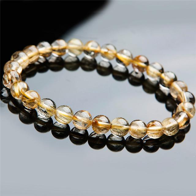 O envio gratuito de mulheres femme 7mm brasileiro genuíno titanium cristal de quartzo rutilado natural ouro amarelo pulseira de pérola redonda