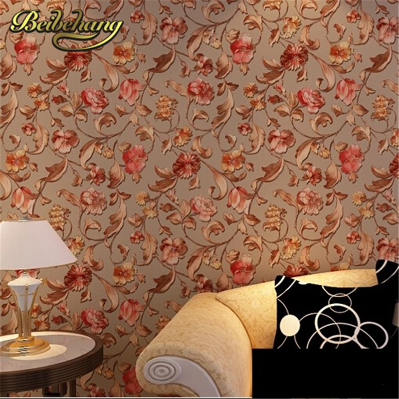 beibehang The high-grade 3D gold relief rose non-woven wallpaper warm pastoral bedroom living room sofa background wallpaper beibehang thick version of the vertical striped wallpaper warm living room bedroom pastoral non woven tv background wallpaper