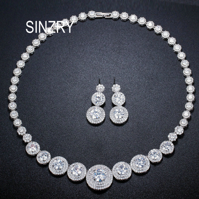 SINZRY Unique design bridal jewelry set white gold color cubic zircon round plate cz luxury wedding necklace earring jewelry set rose gold color shell round simulated pearl element rhinestones micro setting luxury lady jewelry set necklace earring wholesale