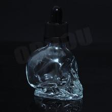 Livraison gratuite 10/lot 30 ml flacon compte gouttes en verre crâne avec bouchon à lépreuve des enfants du fournisseur de la chine