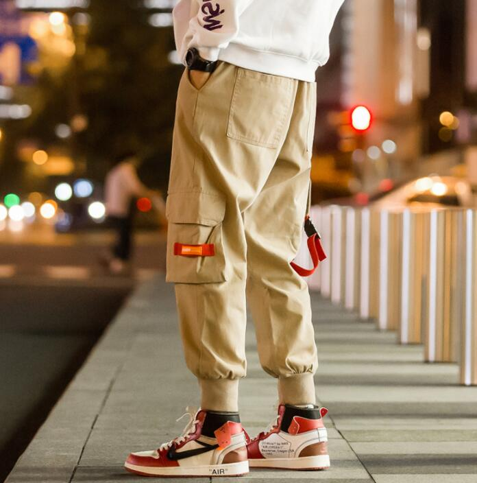Personality fashion harem pants mens trousers pantalones Webbing letter buckle large pocketpants for men pantalon homme in Harem Pants from Men 39 s Clothing