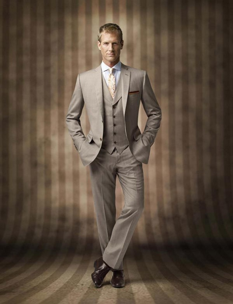 A tan sharkskin notch lapel suit that is the perfect look for that warm weather climate engagement. Try pastel accessories to lighten your look. The men's khaki suit rental features Super 's wool, flat front pants and sizing available in modern fit.