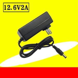 Image 2 - 18650 carregador de bateria de lítio 12.6v 2a 12.6v 1a dc ue eua plug 5.5mm * 2.1mm 100 220v lítio li ion bateria carregador de parede 1m