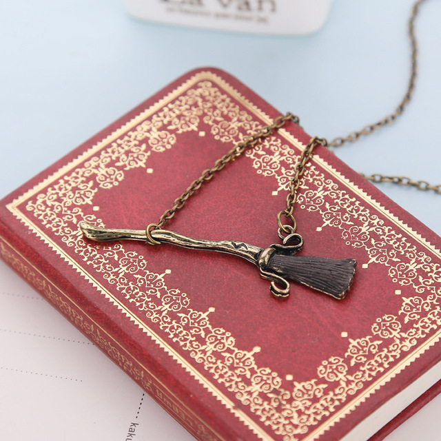 Harry potter from the blue necklace deathly hallows magic broom necklace