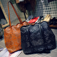 The New High-end Hand-carved Hollow Retro PU Handbags Europe and America Vertical Section Shoulder Bag