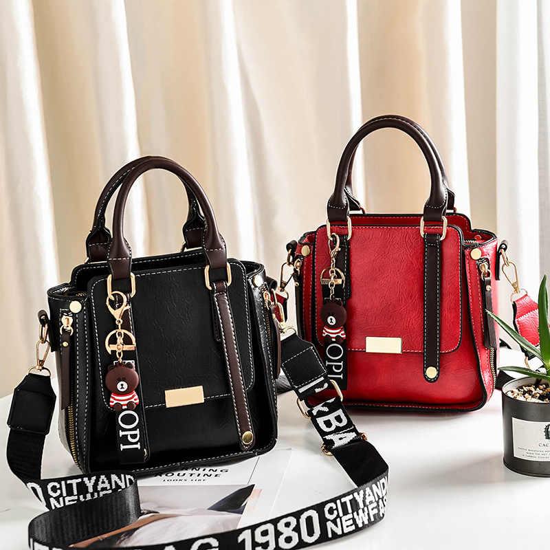Nueva marca de bolsos de hombro para mujer, a la moda bolso de cuero, bolso de diseño para mujer, bolso con borla y oso con cinturón para mujer