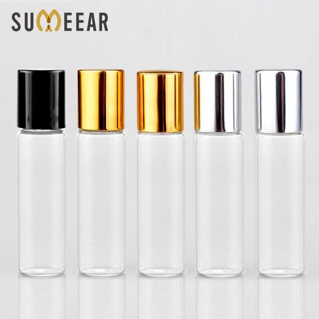 Toptan 100 adet/grup Mini cam parfüm şişeleri üzerinde rulo ile boş kozmetik uçucu yağ seyahat için çelik top ile şişe