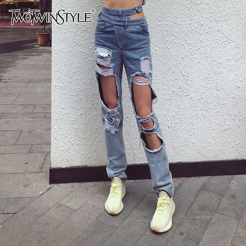 TWOTWINSTYLE Casual Ripped Hole Jeans Women High Waist Hollow Out Irregular Denim Pants Female Fashion Spring 2019 New Tide