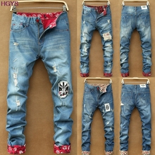 2017 men's garment straight hole loose big yards jeans Fashion teenagers ripped jeans