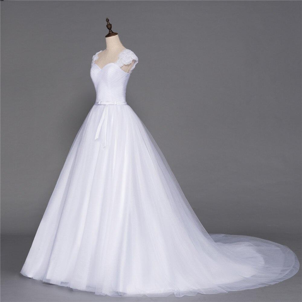 Plus Size Vestido De Noiva 2018 Wedding Dresses A line Cap Sleeves Tulle  Flowers Sash Boho Cheap Wedding Gown Bridal Dresses -in Wedding Dresses from  ... 5552d004d7f1