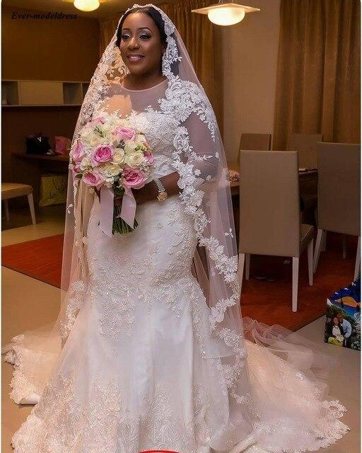Фото свадебное платье с длинным рукавом аппликацией и жемчугом цена