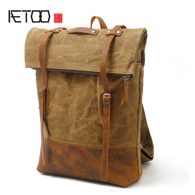 AETOO Canvas shoulder bag men leisure sports backpack batik waterproof outdoor travel bag with the first layer of leather