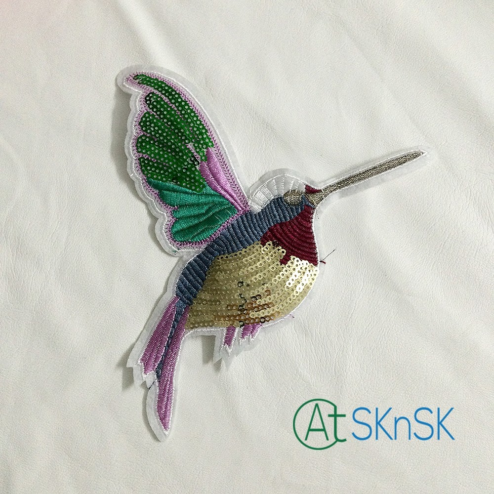 Вышивка крыла птицы
