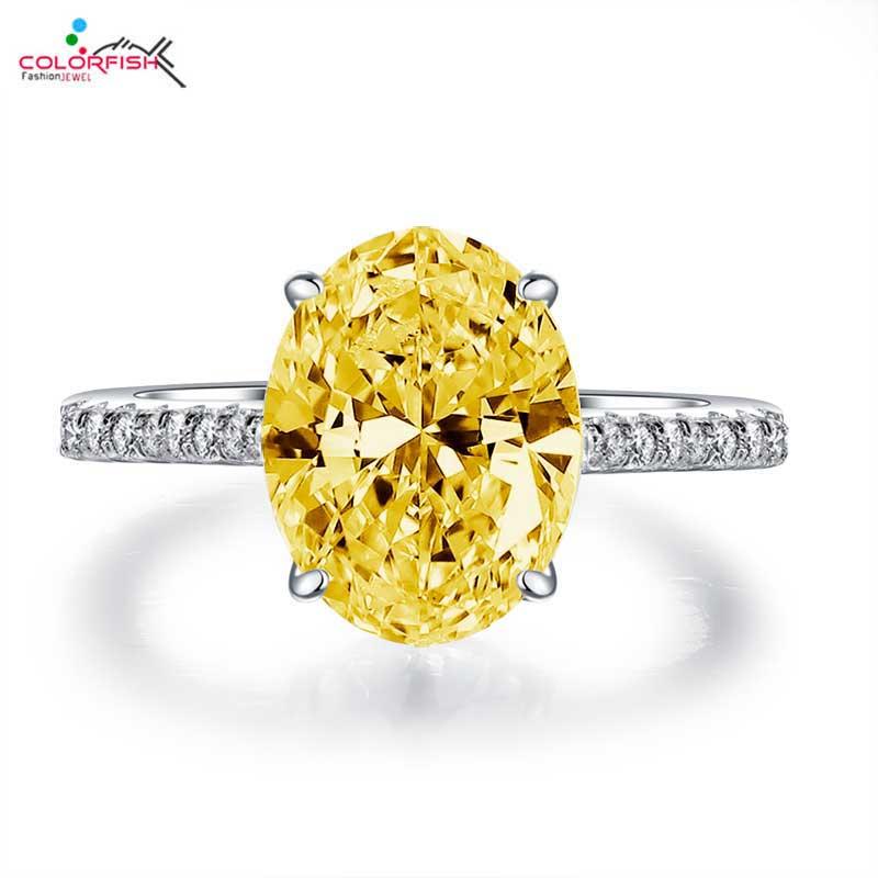 1298c9ea6515 COLORFISH Classic mujeres solitario anillo de compromiso corte ovalado 4 Ct  circón amarillo 925 ...
