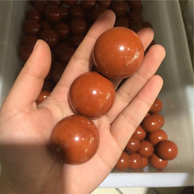 880be847898a Venta al por mayor rojo pulido de piedra jaspe esfera para la decoración  del hogar