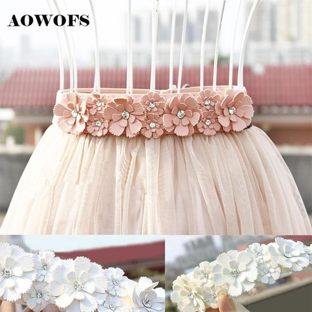 Cinturones de vestir de mujer cinturón de flores de cintura elástica de  cuero PU para fiesta d0cfb0bab347