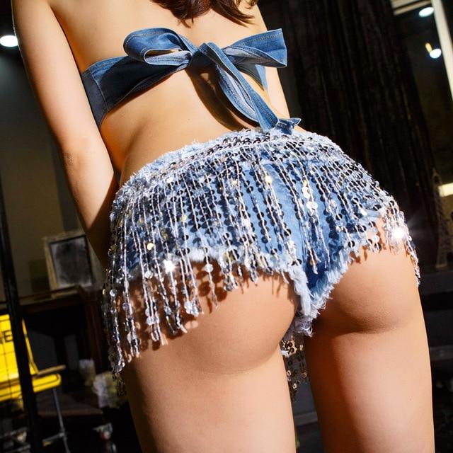 2016 Verano Nueva Hot Denim Shorts Mujeres Sexy Club de Lentejuelas borla Super Baja Cintura Shorts Feminino Bragas Mini Disco Corto pantalones vaqueros