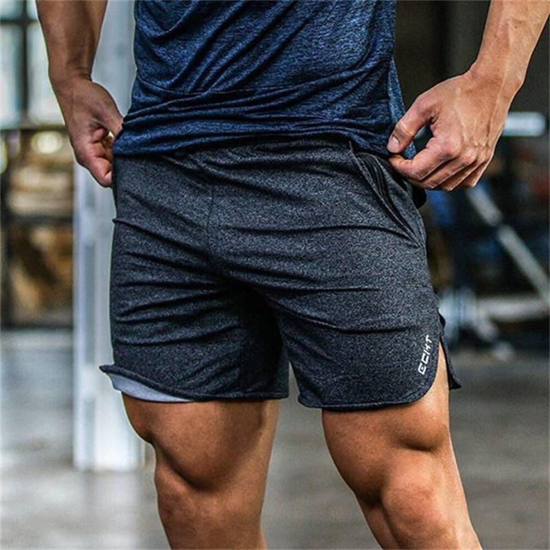 Verano nuevo Mens Fitness pantalones cortos casuales de moda de los gimnasios de culturismo entrenamiento hombre becerro longitud corta pantalones marca chándal ropa deportiva