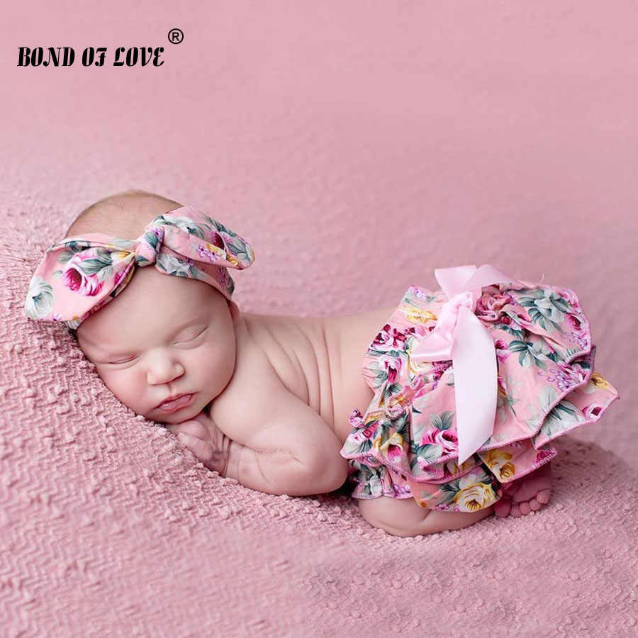 Size 0 or 1. Baby girls bloomer shorties with headwrap Floral print