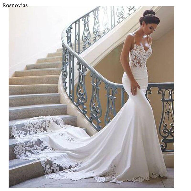 Robes de mariée de luxe sirène 2019 sangle Spaghetti sans manches Long Train dentelle Appliques modestes élastiques Satin robes de mariée