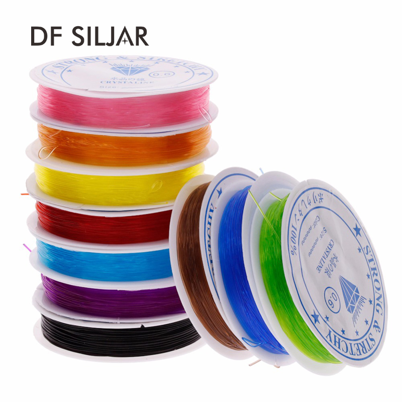 A roll of crystal clear elastic cord//thread//wire 0.6mm approx 10m