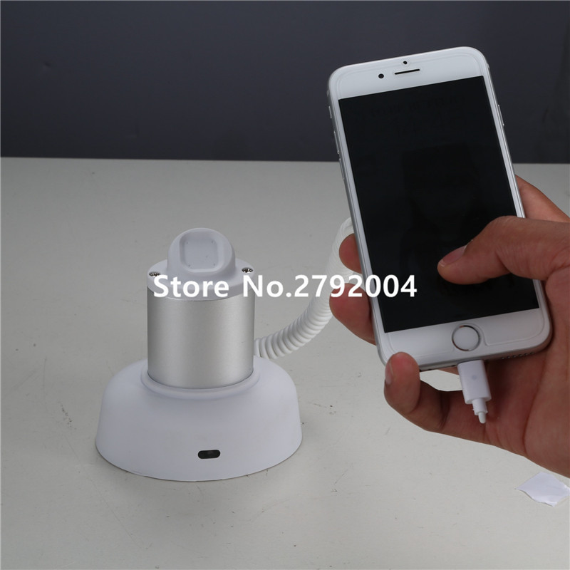 цена на Mobile phone security display holder cellphone anti-theft stand smart phone alarm bracket for cell phone+Remote control/Charger