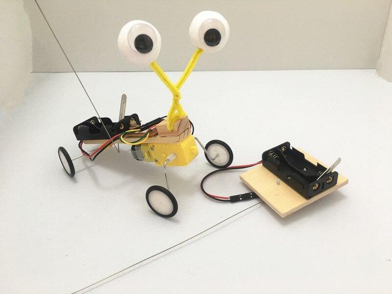 Izvedba eksperimentalnog eksperimenta Happyxuan Diy Telecontrol Robot - Izgradnja igračke - Foto 2