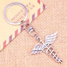 цена на 20pcs New Fashion Keychain 40*40 mm caduceus medical symbol md Pendants DIY Men Jewelry Car Key Chain Souvenir For Gift