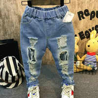 2019 nuovo bambino di modo del ragazzo e della ragazza dei jeans del foro pantaloni del cotone dei capretti del denim dei pantaloni lunghi per i bambini di vendita al dettaglio