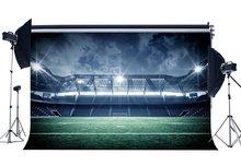 Toile de fond de terrain de Football décors de stade brillant lumières de scène intérieur vert herbe prairie photographie fond