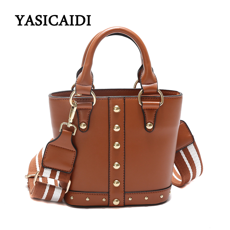 купить Famous Brand PU Leather Female Handbag 2018 New Rivet Shoulder Bag Women Tote Bag Fashion Daily Vintage Women Bag Causal Tote по цене 2229.42 рублей