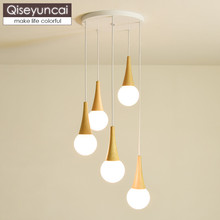 Qiseyuncai Nordic log three-head combination restaurant chandelier modern minimalist bar glass ball magic bean lighting