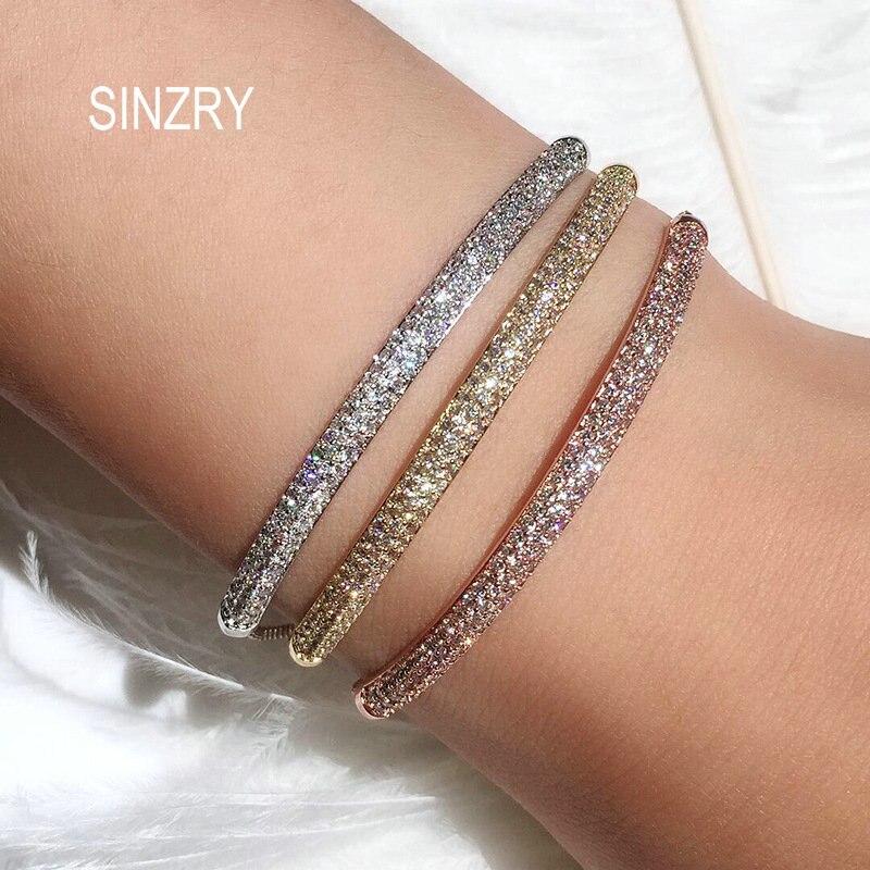 SINZRY venta al por mayor Nueva joyería AAA corte circonio cúbico exquisito arco encanto CZ pulseras y brazalete para mujer joyería de moda bling