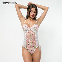 Hoyyezen sexy white jumpsuits for women 2019 printed flower lace stitching perspective straps bodysuit