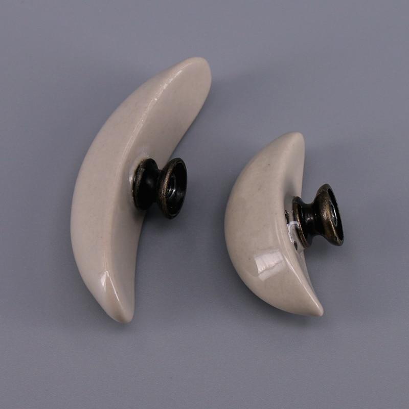 US $1.76 12% di SCONTO 1x In Ceramica Forma di Mezzaluna Da Cucina Maniglie  Del Cassetto Armadi Pomelli In Ceramica Porta Armadio Dresser Manopola ...