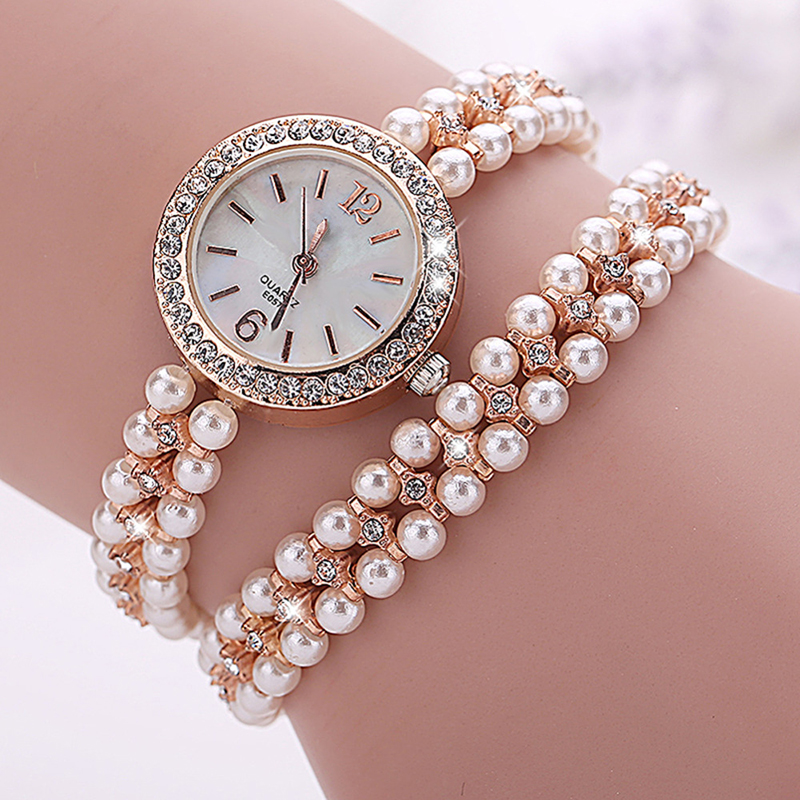 купить Fashion Brand Quartz Watch Women Pearl Bracelet Watch Gold Women Watches Ladies Jewellery watches montre bijoux femme по цене 304.63 рублей
