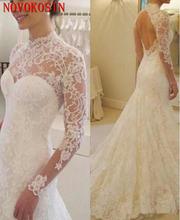 Кружевное свадебное платье с открытой спиной и длинным рукавом