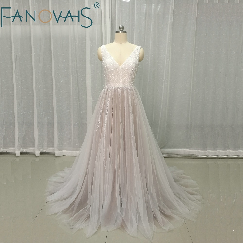 2019 Sexy Backless Tulle Wedding Dresses Ivory Deep V Neck Wedding Gowns Luxury Crystal Beads Vestido